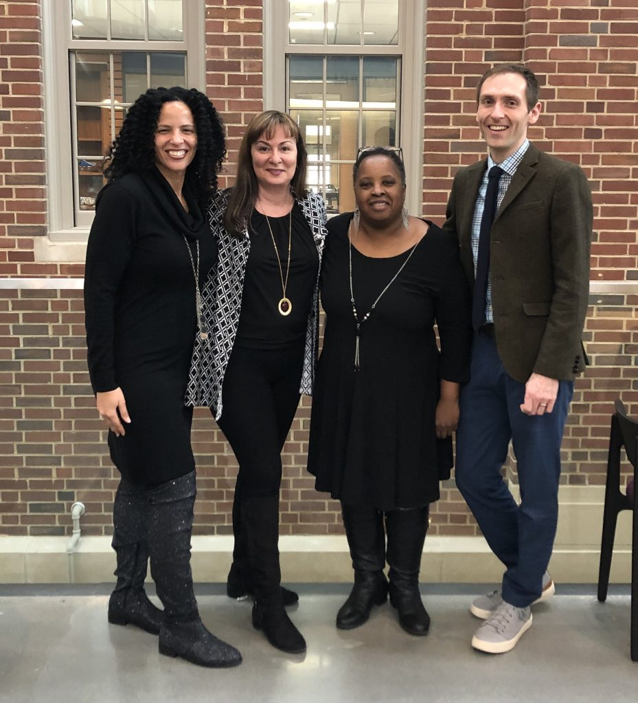 Raychelle Burks, Maria Gallardo-Williams, Mary Crawford, and Mitch Anstey standing in the Wall Academic Center having a good time!