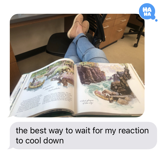 a book laying open across a person's legs while they wait for their work to start.