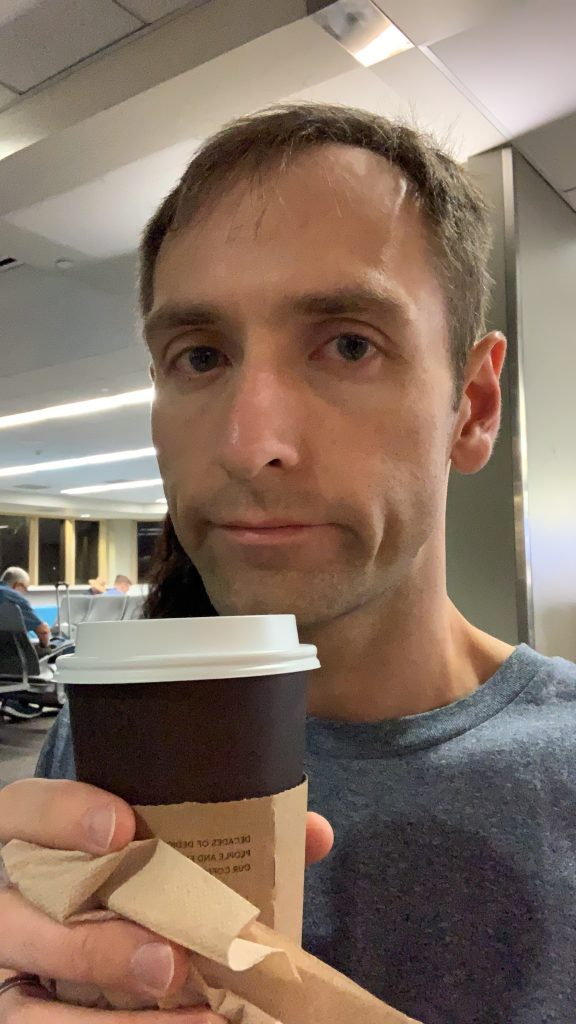Close up shot of person drinking coffee with a sad frown