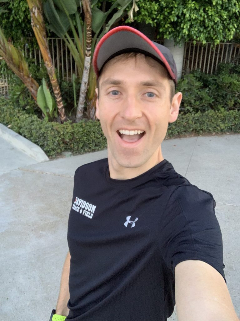 Mitch smiling for the camera right before beginning a morning jog