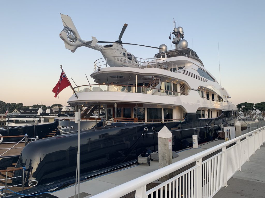 A fancy yacht with a helicopter on its roof