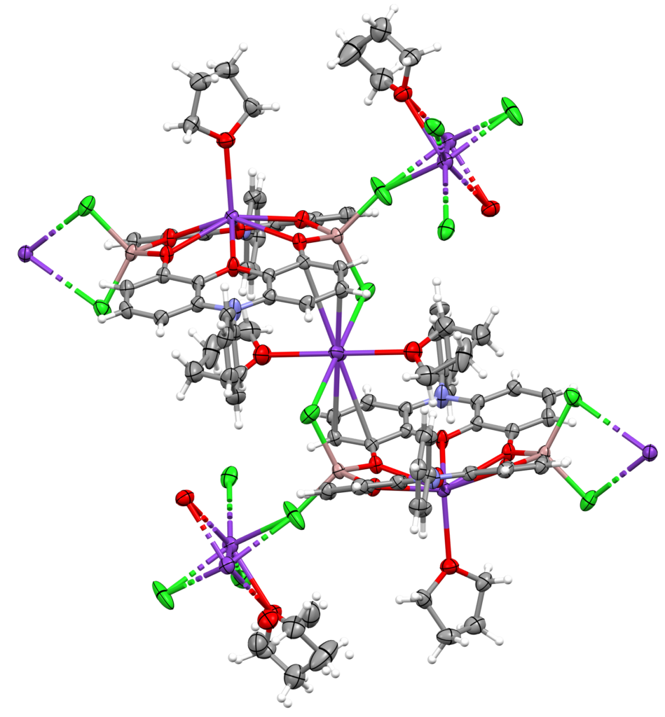 a molecular structure of a molecule viewed as a series of balls and sticks. The compound is a polymeric interlinked structure of phenoxazines and potassium cations.